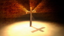 Royalty Free Video of a  Rotating Illuminated Cross With Handwritten Pages in the Background