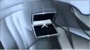 Royalty Free Video of an Engagement Ring in a Box with Shimmering Grey Background