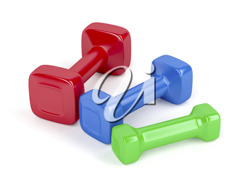 Three dumbbells with different sizes and colors on white background