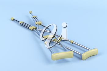 Pair of underarm crutches on blue background