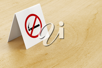 No smoking sign on wooden table in the restaurant or cafe