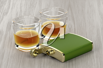 Green hip flask and two glasses of whisky on wooden table