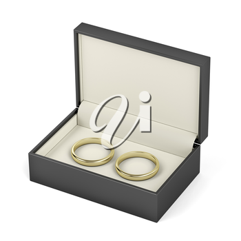 Box with gold wedding rings on white background