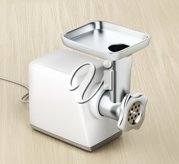 Electric meat grinder on a wood table
