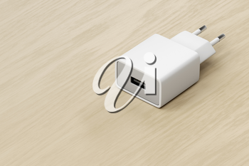 Smartphone, tablet or other electronic device charger with USB port on the wooden table