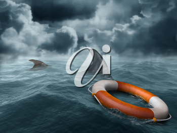 Royalty Free Clipart Image of a Lifebuoy in the Water Surrounded by Sharks