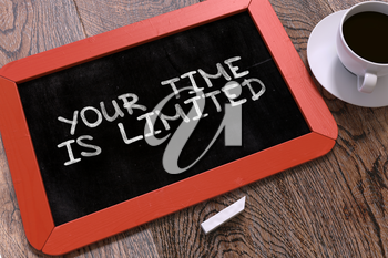 Your Time is Limited Concept Hand Drawn on Red Chalkboard on Wooden Table. Business Background. Top View. 3D Render.