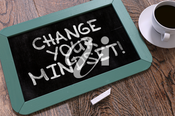 Change Your Mindset Handwritten on Blue Chalkboard. Business Concept. Composition with Chalkboard and Cup of Coffee. Top View Image. 3D Render.