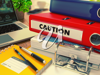 Red Office Folder with Inscription Caution on Office Desktop with Office Supplies and Modern Laptop. Business Concept on Blurred Background. Toned Image. 3D Render.