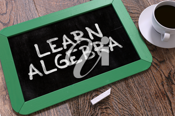 Learn Algebra Concept Hand Drawn on Green Chalkboard on Wooden Table. Business Background. Top View. 3D Render.