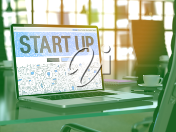 Start Up - Closeup Landing Page in Doodle Design Style on Laptop Screen. On Background of Comfortable Working Place in Modern Office. Toned, Blurred Image. 3D Render.