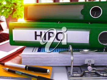 Green Office Folder with Inscription HiPo - High Potential - on Office Desktop with Office Supplies and Modern Laptop. HiPo Business Concept on Blurred Background. Hipo - Toned Image. 3D.