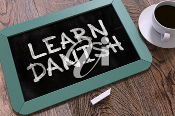 Learn Danish Concept Hand Drawn on Blue Chalkboard on Wooden Table. Business Background. Top View. 3D Render.