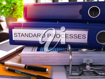 Standard Processes - Blue Ring Binder on Office Desktop with Office Supplies and Modern Laptop. Standard Processes Business Concept on Blurred Background. 3D Render.