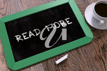 Hand Drawn Read More Concept  on Small Green Chalkboard. Business Background. Top View. 3D Render.