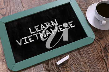 Hand Drawn Learn Vietnamese Concept  on Small Blue Chalkboard. Business Background. Top View. 3D Render.
