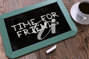 Time for Friends - Blue Chalkboard with Hand Drawn Text and White Cup of Coffee on Wooden Table. Top View. 3D Render.
