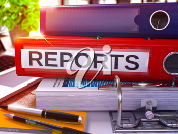 Reports - Red Office Folder on Background of Working Table with Stationery and Laptop. Reports Business Concept on Blurred Background. Reports Toned Image. 3D.