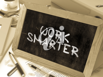 Work Smarter Handwritten by White Chalk on a Blackboard. Composition with Small Chalkboard on Background of Working Table with Office Folders, Stationery, Reports. Blurred, Toned Image. 3D Render.