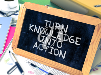 Turn Knowledge into Action Handwritten on Chalkboard. Composition with Small Chalkboard on Background of Working Table with Ring Binders, Office Supplies, Reports. Blurred, Toned Image. 3D Render.