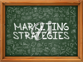Marketing Strategies - Hand Drawn on Chalkboard. Marketing Strategies with Doodle Icons Around.