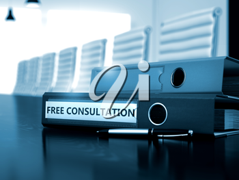 Free Consultation - Business Concept on Blurred Background. Ring Binder with Inscription Free Consultation on Office Black Desktop. 3D.