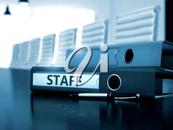 Staff - Business Concept. Staff - Folder on Office Wooden Desktop. Staff - Business Concept on Blurred Background. Office Binder with Inscription Staff on Wooden Desktop. 3D.