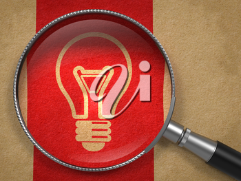 Magnifying Glass with Light Bulb Icon on Old Paper with Red Vertical Line Background. Idea Concept.