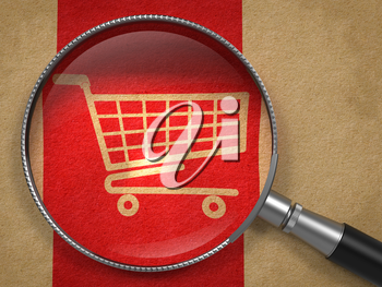 Magnifying Glass with Shopping Cart Icon on Old Paper with Red Vertical Line Background. Business Concept.
