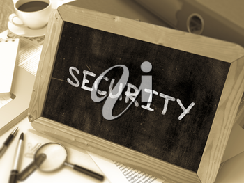 Security Concept Hand Drawn on Chalkboard on Working Table Background. Blurred Background. Toned Image. 3D Render.