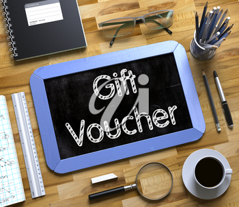 Gift Voucher. Business Concept Handwritten on Blue Small Chalkboard. Top View Composition with Chalkboard and Office Supplies on Office Desk. Small Chalkboard with Gift Voucher Concept. 3d Rendering.
