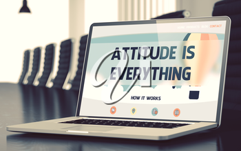 Modern Meeting Hall with Laptop Showing Landing Page with Text Attitude Is Everything. Closeup View. Toned Image. Blurred Background. 3D.