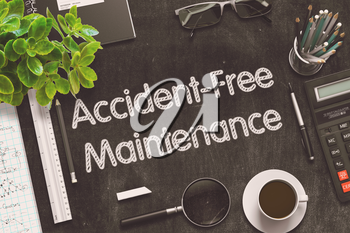 Accident-Free Maintenance. Business Concept Handwritten on Black Chalkboard. Top View Composition with Chalkboard and Office Supplies. 3d Rendering. Toned Illustration.
