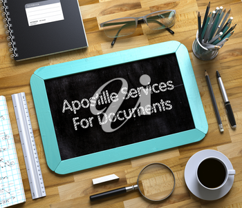 Apostille Services For Documents - Mint Small Chalkboard with Hand Drawn Text and Stationery on Office Desk. Top View. Apostille Services For Documents Handwritten on Small Chalkboard. 3d Rendering.