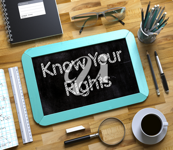 Know Your Rights Handwritten on Mint Small Chalkboard. Top View of Wooden Office Desk with a Lot of Business and Office Supplies on It. Know Your Rights on Small Chalkboard. 3d Rendering.