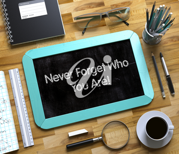 Never Forget Who You Are Concept on Small Chalkboard. Top View of Office Desk with Stationery and Mint Small Chalkboard with Business Concept - Never Forget Who You Are. 3d Rendering.