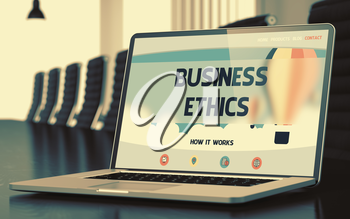 Modern Conference Room with Laptop on Foreground Showing Landing Page with Text Business Ethics. Closeup View. Toned Image. Selective Focus. 3D.