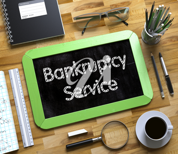 Bankruptcy Service - Text on Small Chalkboard.Bankruptcy Service Handwritten on Green Small Chalkboard. Top View of Wooden Office Desk with a Lot of Business and Office Supplies on It. 3d Rendering.