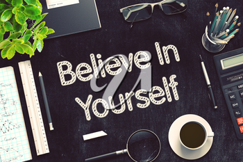 Believe In Yourself Handwritten on Black Chalkboard. Top View Composition with Black Chalkboard with Office Supplies Around. 3d Rendering. Toned Illustration.