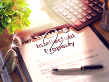 Intellectual Property on Clipboard. Office Desk with a Lot of Office Supplies. 3d Rendering. Blurred and Toned Image.