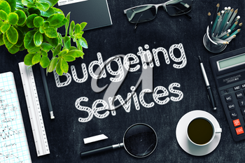 Budgeting Services Handwritten on Black Chalkboard. Top View of Black Office Desk with a Lot of Business and Office Supplies on It. 3d Rendering. Toned Image.