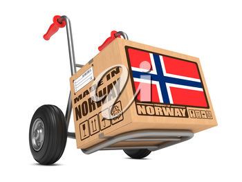 Cardboard Box with Flag of Norway and Made in Norway Slogan on Hand Truck White Background. Free Shipping Concept.