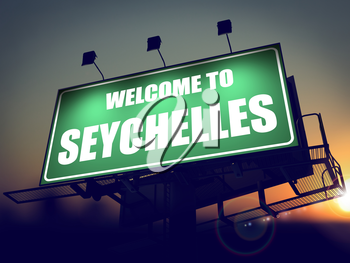 Welcome to Seychelles - Green Billboard on the Rising Sun Background.