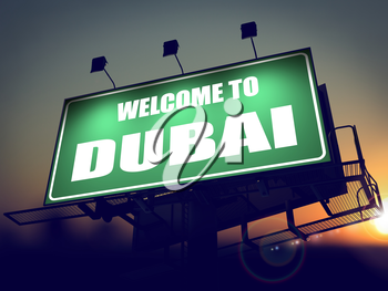 Welcome to Dubai - Green Billboard on the Rising Sun Background.