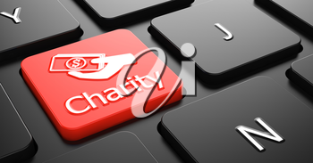 Charity with Money in the Hand Icon - Red Button on Black Computer Keyboard.