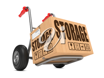 Cardboard Box with Storage Slogan on Hand Truck White Background.