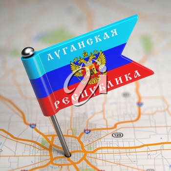 Small Flag of Luhansk People's Republic- Sticked in the Map Background with Selective Focus.