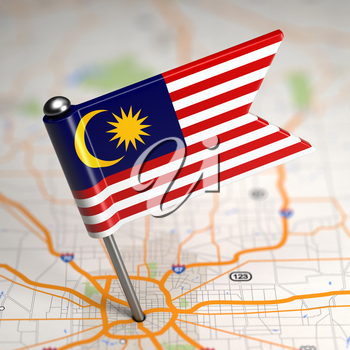 Small Flag of Malaysia Sticked in the Map Background with Selective Focus.