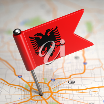 Small Flag of Republic of Albania Sticked in the Map Background with Selective Focus.