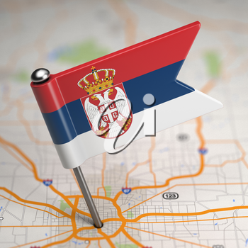 Small Flag of Serbia on a Map Background with Selective Focus.